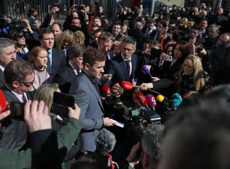 Ireland rugby player Paddy Jackson (centre) speaking outside Belfast Crown Court, 28 March 2018.