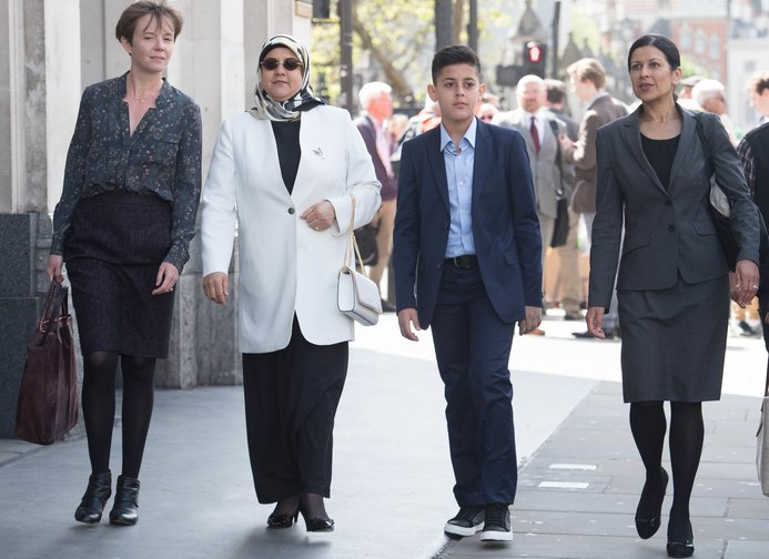 Fatima Boudchar and her son Abderrahim Belhaj, 14, with lawyers (far left) Cori Crider and (far right) Sapna Malik from Reprieve arriving at the Houses of Parliament in London for a formal apology, May 10, 2018.
