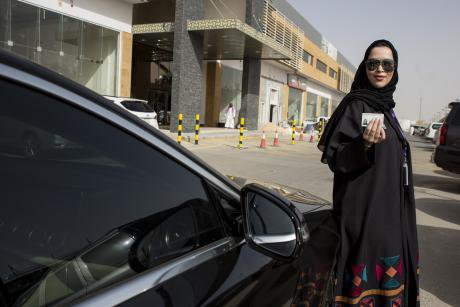 A Saudi woman poses with her new driving license after the country's ban on women driving was lifted in June, 2018.