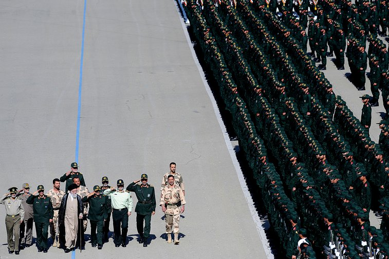 Ranks of soldiers with small group of men reviewing them