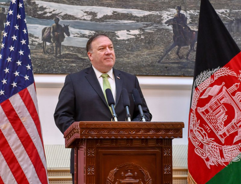 Pompeo on unannounced visit to Afghanistan pledging US support for peace talks with the Taliban, July 2018.