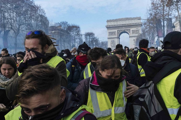 Thousands gathered on the Champs-Elysees as tear gas and rubber bullets used to disperse demonstrators. Paris, December, 2018.