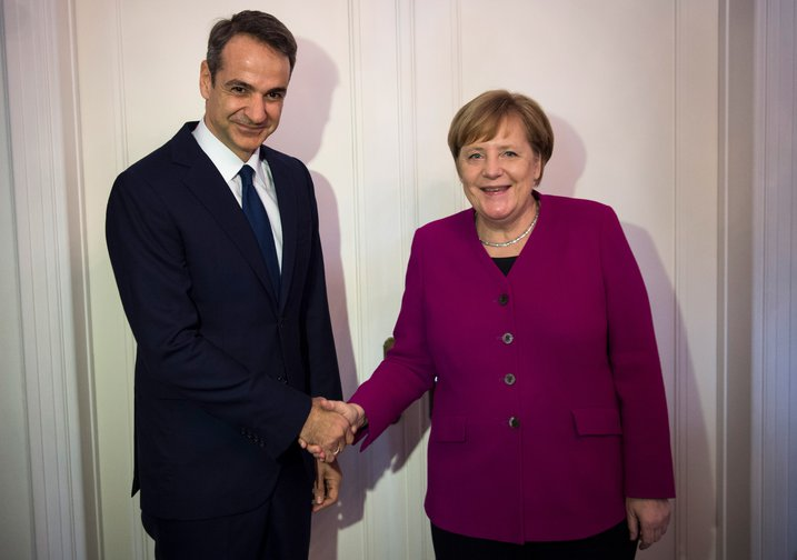 Angela Merkel shakes hands with Kyriakos Mitsotakis, leader of the conservative Greek opposition, soon to be Greek prime minister, January 2019.