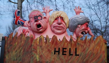 Effigies of Theresa May, Boris Johnson, Michael Gove and David Davis are driven past the Houses of Parliament. 13 Feb 2019