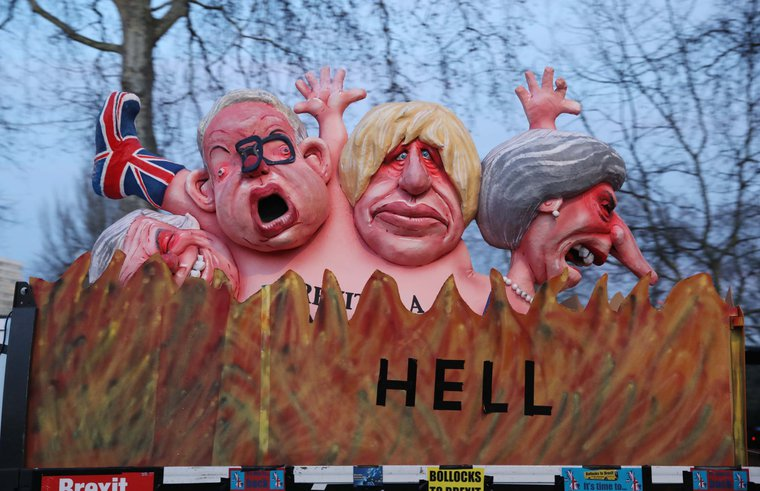 Effigies of Prime Minister Theresa May, former foreign secretary Boris Johnson, Environment Secretary Michael Gove and former Brexit secretary David Davis, are driven past the Houses of Parliament, London. 13 Feb 2019