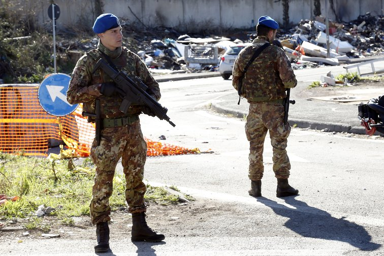 Soldiers stationed outside a Roma camp in Tor Sapienza, March 2019.