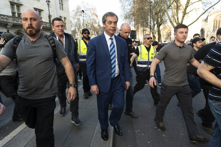 Leader of the British Brexit Party Nigel Farage leaves after speaking at a rally in London, on March 29, 2019..