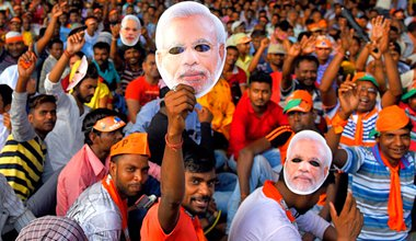 Supporters of BJP waving masks of the prime minister Narendra Modi