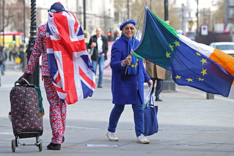 Both pro and anti-Brexit protesters in Westminster, London, after the European Council in Brussels agreed to a second extension to the Brexit process.