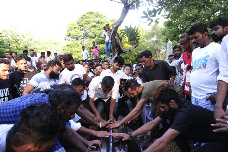 April 24, 2019 - Relatives at the funeral of a victim of the terrorist attacks in Sri Lanka