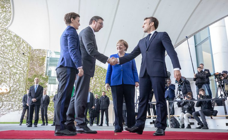 29 April 2019, Berlin: Merkel welcomes Macron and Aleksandar Vucic, President of Serbia, and Ana Brnabic, Prime Minister of Serbia, to the Balkan Conference in Berlin.