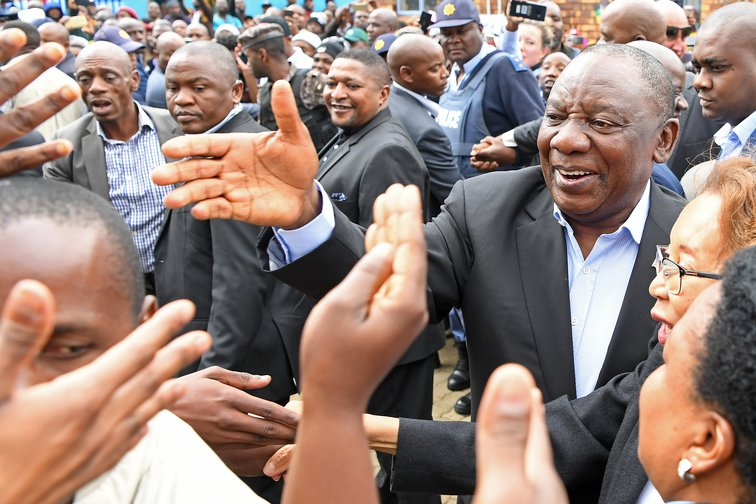 South African President Cyril Ramaphosa greets voters at a polling station in Johannesburg, South Africa, on May 8, 2019.