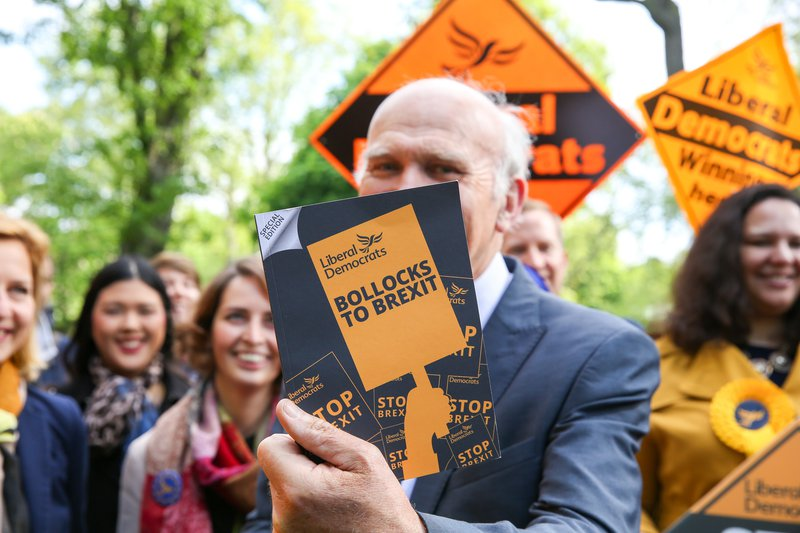 The leader of Liberal Democrats Vince Cable holding the party manifesto for the forthcoming European Elections