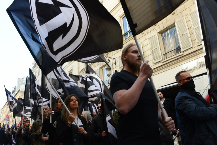 The far-right group Action Française march through Paris in May, 2019.