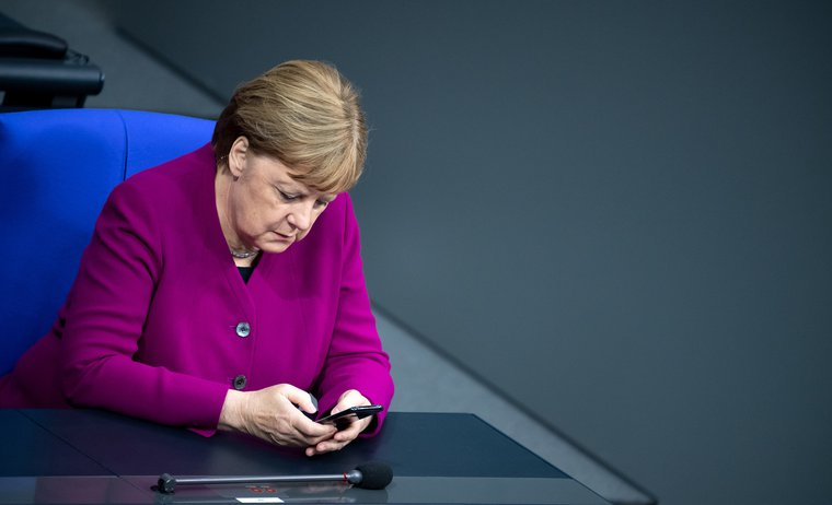 Angela Merkel reading.