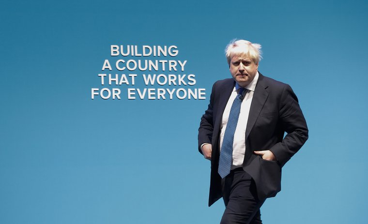 Boris Johnson walking onstage at the Conservative Party's annual conference in Manchester, 2017.