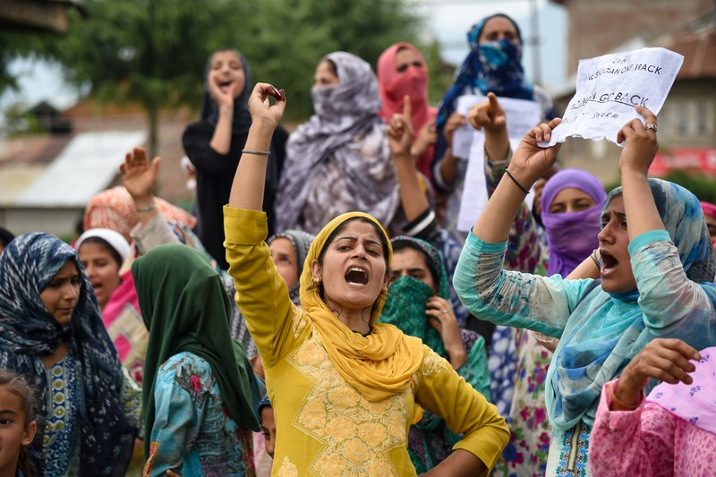 Women in Kashmir lead a chant in a protest against India's revocation of Kashmir's autonomy.
