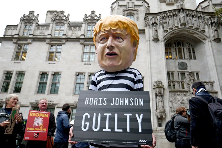 A man wearing a giant Boris Johnson mask outside the Supreme Court in London