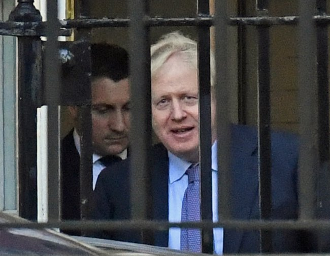 Boris Johnson seen through railings
