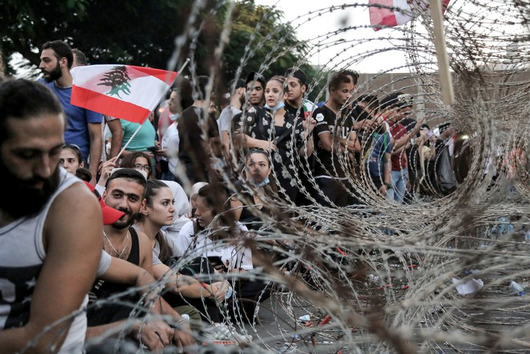 Protestors confronted by barbed wire during a demonstration in Beirut. October, 2019.