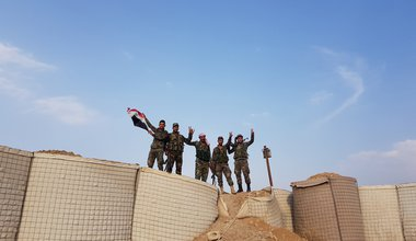 Syrian soldiers prepare to hoist the Syrian flag at a previous U.S.-run military base in the village of Qasr Yalda in the western countryside of Hasakah province, northeastern Syria, Oct. 19, 2019