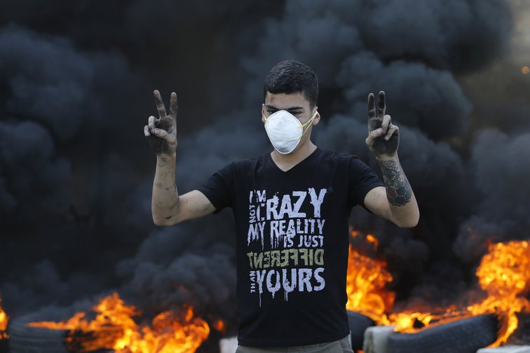 Lebanon nationwide protests in front of burning tyres in Khaldeh, south of Lebanon, Nov. 13, 2019.