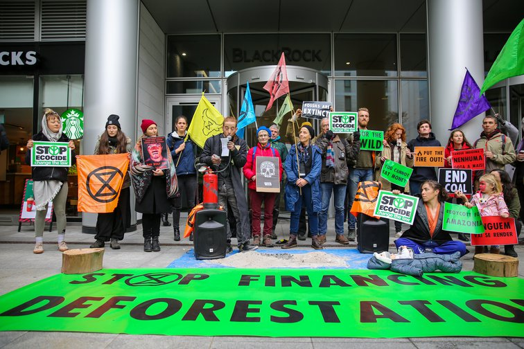 Activists from Extinction Rebellion climate change group protesting outside the London offices of asset manager, BlackRock