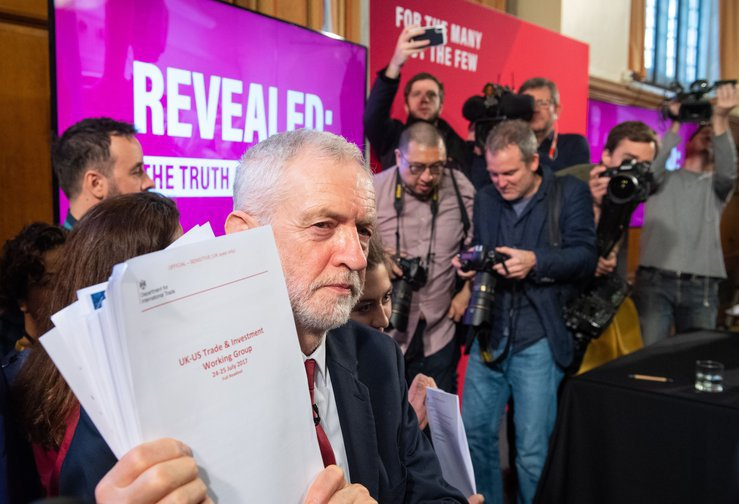 Jeremy Corbyn holds an unredacted copy of a readout of the US/UK working group talks on a trade deal.