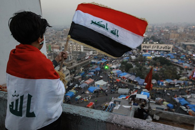 Boy overlooks anti-government sit-in in Tahrir Square, Baghdad, December 26, 2019