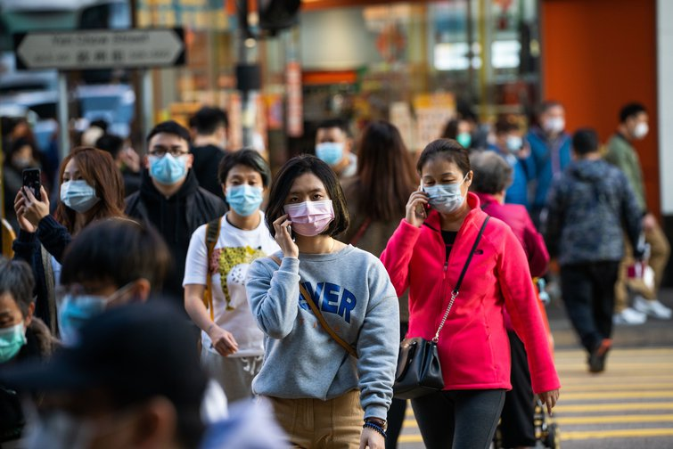 People wearing masks in the streets of Hong Kong after the outbreak of Coronavirus in Wuhan.