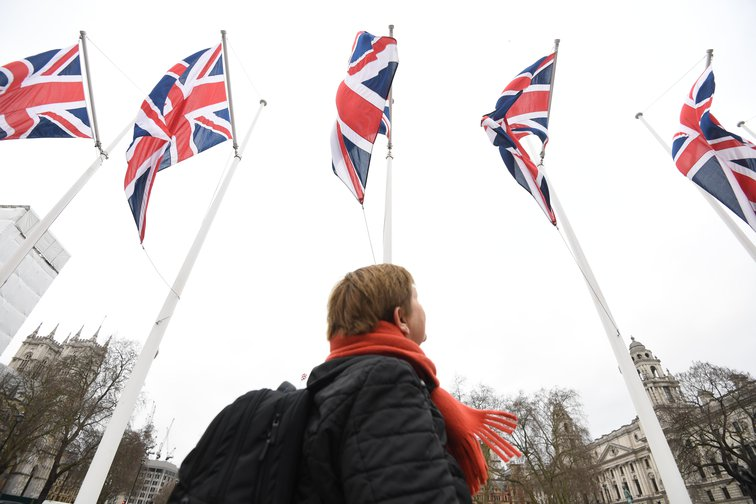 Woman looking at Union flags