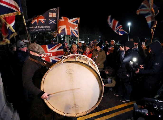 Pro-Brexit supporters with Union flags and drums