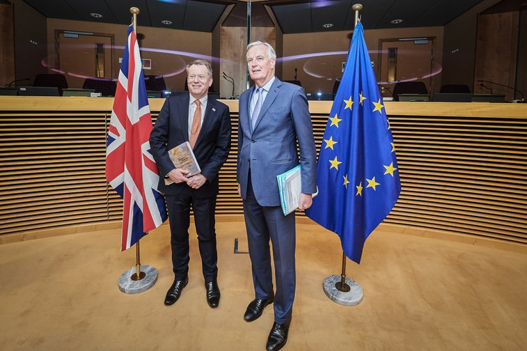European Union chief Brexit negotiator Michel Barnier (R) and the UK chief Brexit negotiator David Frost pose for a photo before the start of the first post-Brexit trade talks between the EU and the United Kingdom