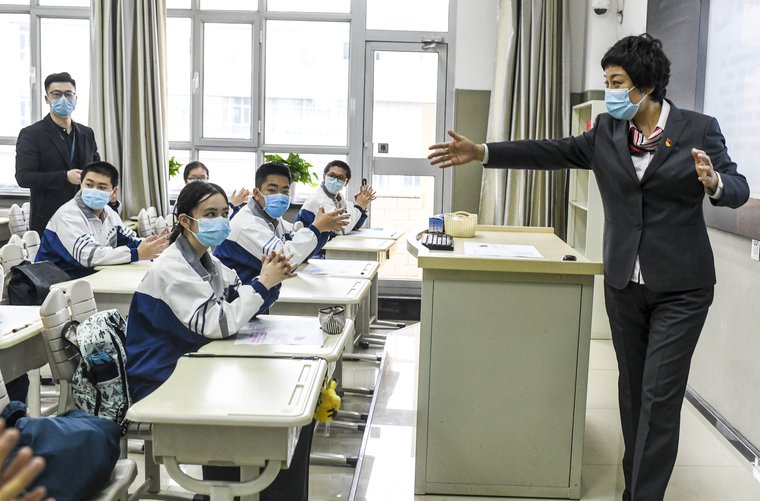 Urumqi No.1 Senior High School class in Urumqi, Xinjiang reopens warily on March 16, 2020.