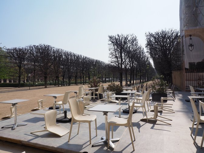 An empty café in the park of the Palais Royal, Paris, France, 28 March 2020.