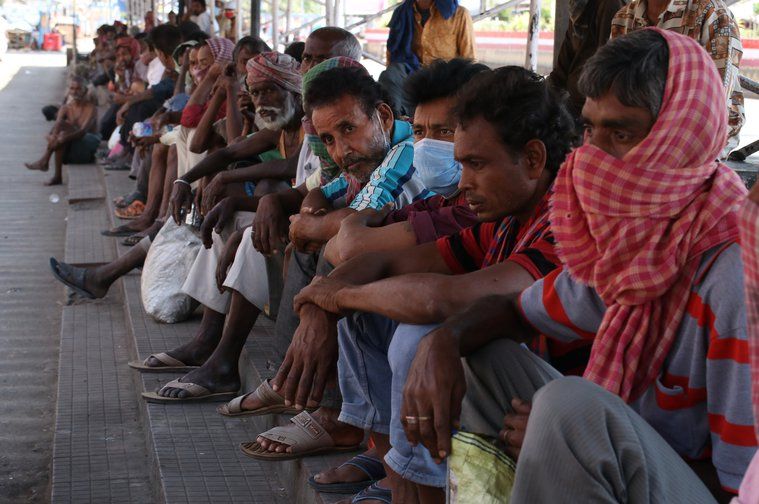 Migrant workers queue for food outside Howrah railway station during lockdown, Kolkata, March 29, 2020.