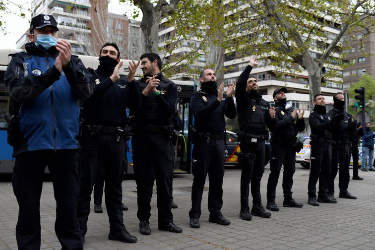 National police applaud health care workers in Madrid, March 30, 2020.
