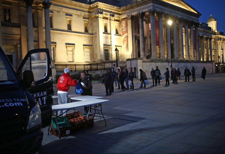 Sikh Welfare & Awareness Team serving hot meals and drinks to the homeless and less fortunate from their van in Trafalgar Square, London, April 8, 2020.