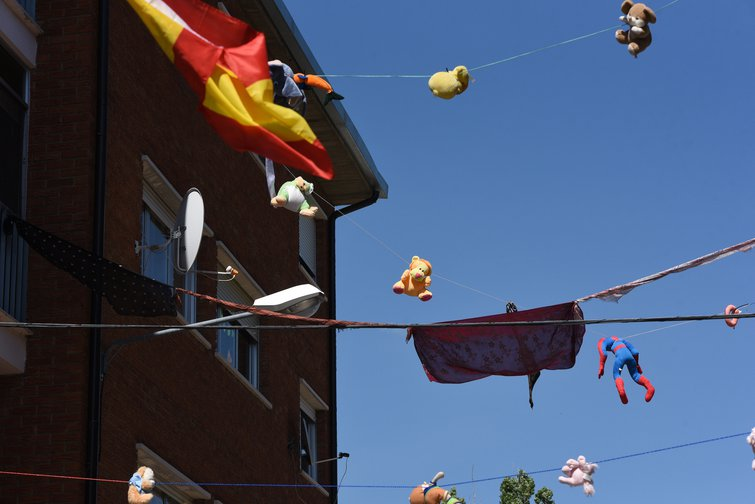 Neighbours hang dozens of toys from balcony to balcony to entertain children in the Soria province of Spain, where Covid-19 confinement has been longest.