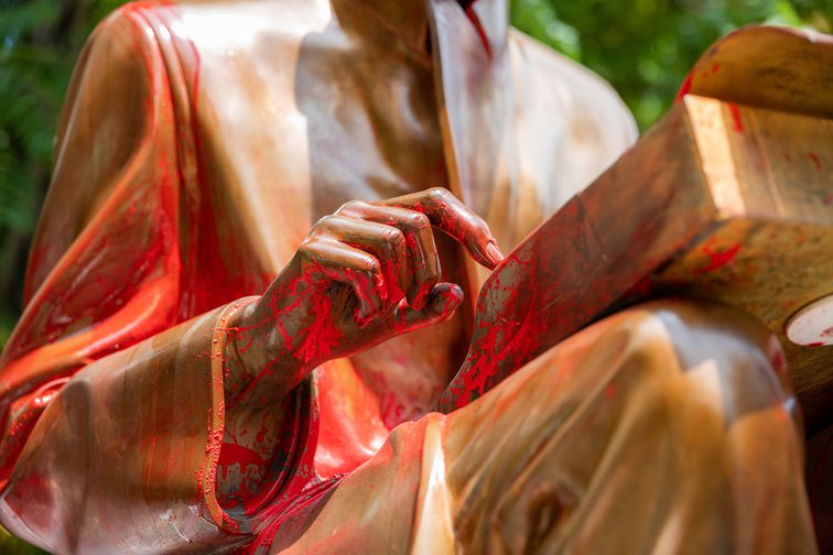 Indro Montanelli statue in the park dedicated to him daubed with red paint, June 14, 2020, Milan, Italy.