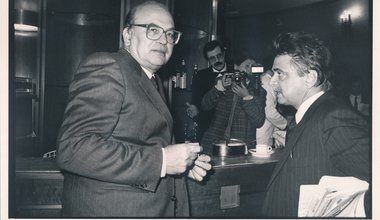 Secretary of the Italian Socialist Party Bettino Craxi and Secretary of the Democrats of the Left Achille Occhetto having a conversation in a bar. Italy, 1990s