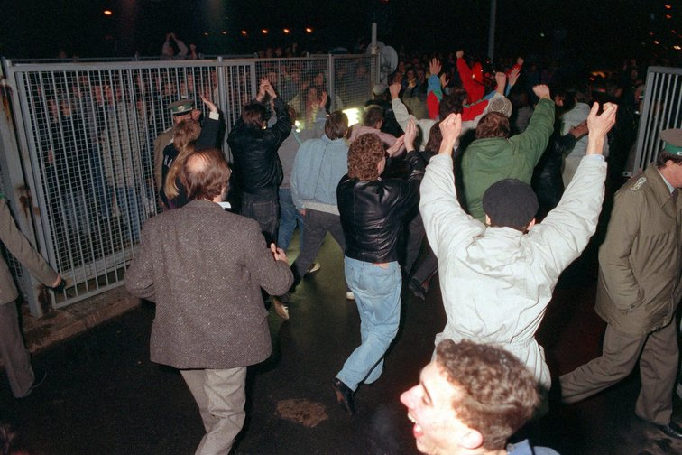 People enthusiastically embark on a border crossing on the night of November 10, 1989, Berlin.