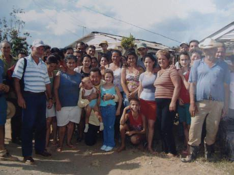 Hugo Chavez surrounded in a tight group by people of San Andres following a hurricane