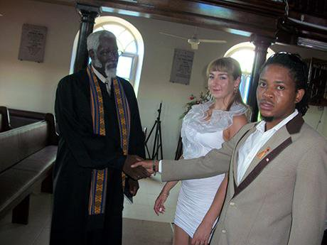 Man and woman in church with priest