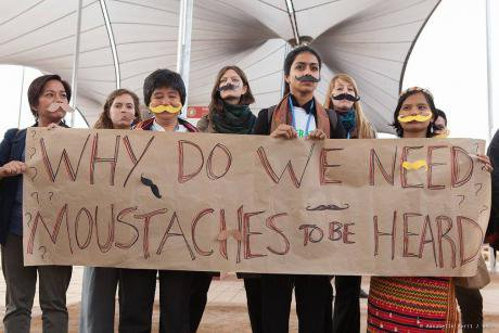 Activists demanding women's voices be heard at COP22.