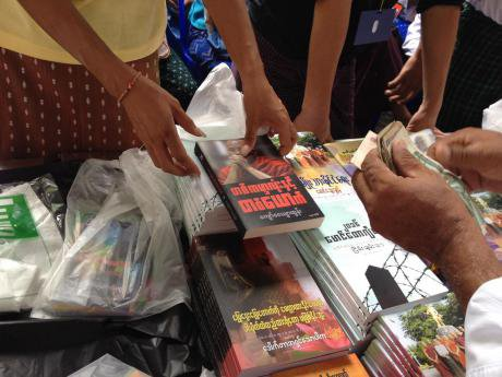 A woman sells books promoting MaBaTha, at the movement's 2017 annual conference in Yangon.