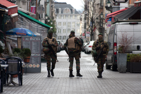 Police patrol the streets of Brussels, Belgium. CRM / Shutterstock. All Rights Reserved.