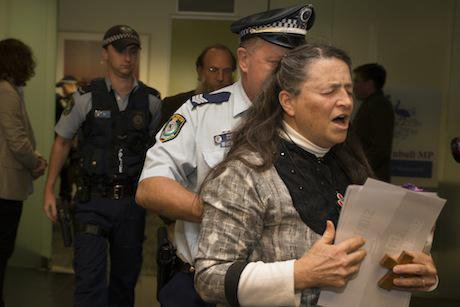 Police remove Christians from prayer sit-in for asylum seekers at Malcolm Turnbull's office. Jeff Tan:Flickr. Some Rights Reserved.jpg