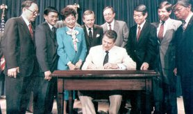 President Reagan signing the Civil Liberties Act into law, 1988.