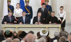 Vladimir Putin formally integrates Crimea into the Russia, flanked by Sergei Aksyonov and Aleksei Chaly.